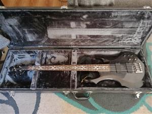 ESP Ltd F404 Electric 4 string bass guitar with hard case.