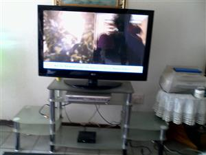 110cm colour plasma TV and remote control and glass stand