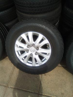 17 inch Mazda rim with a used tyre