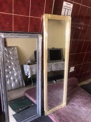 Tall beige and silver framed mirrors