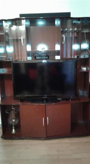 Large wooden tv stand with flat screen tv