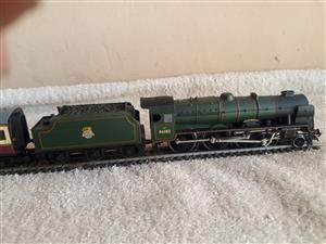 Rebuilt Scot Locomotive and three carraiges