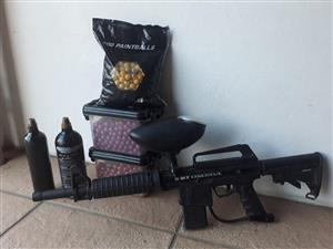 Paintball Rifle. BT Omega. Two gas bottles and 1500 paintballs, of three different colors.   Excellent condition.