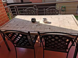 4 seater cast iron patio table is for sale