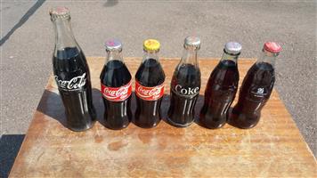 Vintage Coke Bottles x 6 plus 2 coke openers