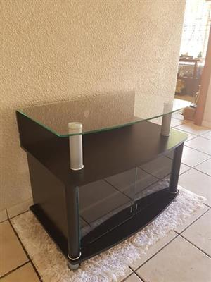 Plasma tv stand with glass top and cupbaord