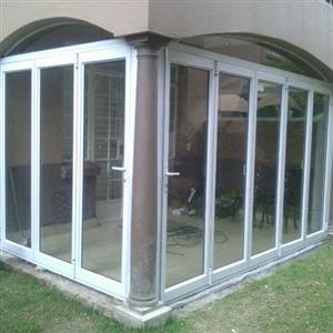 Patio enclosures with aluminium stack fold doors