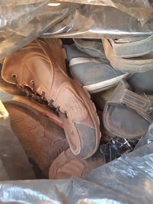 Bag full of men's shoes and sandals