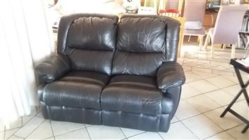 Two seater leather recliner couch