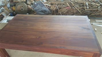 Solid all brown kiaat table