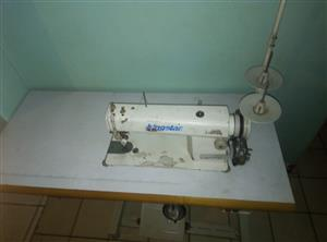 Selling a kingstar industrial straight sewing machine R3200 complete with motor and table as good as new.