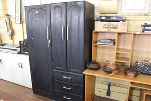 3 Door dark wooden cupboard with drawers