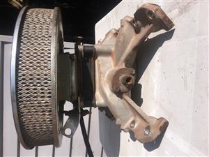 Land Rover 3.9L V8 carburetor conversion.