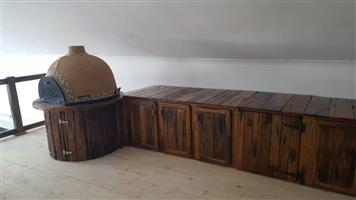 Variety of kitchen furniture including pizza oven, braai oven