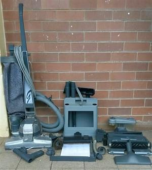 Kirby 4 vacuum cleaner with accessories and manual. In working condition.