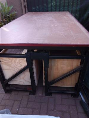 Large woodworking bench with metal frame and loads of storage space