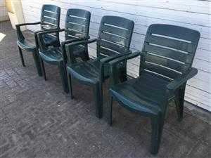Set of 4 Green Plastic stacking armchairs