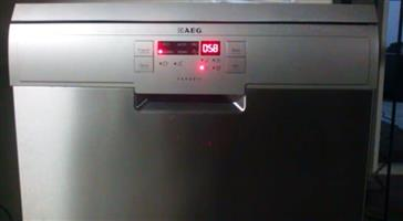 AEG stainless steel 13 place setting dishwasher with manual for sale in brand new condition