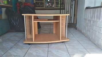 Light wooden desk with dvd holders