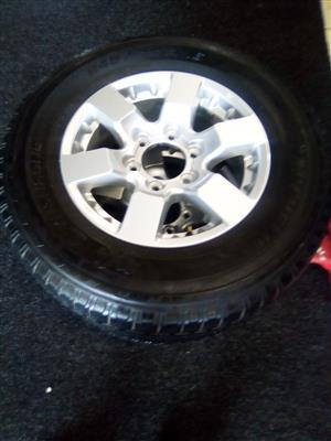 16 inch Nissan Navara with 245/70/16 used tyre for sparewheel R1500.