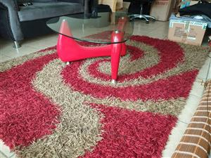 Cosmos Turkiye Long Hair Carpet....Excellent Condition....PLUS Glass Top Coffee Table (tempered and modern)....Excellent Condition.