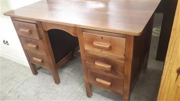 Refurbished, wooden six-drawer desk