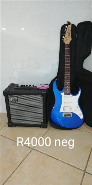 Blue guitar and amp for sale