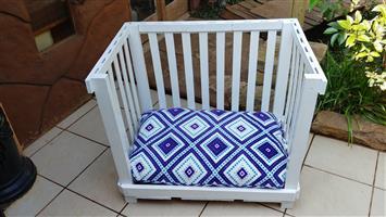 Awesome white wooden slat dog bed.