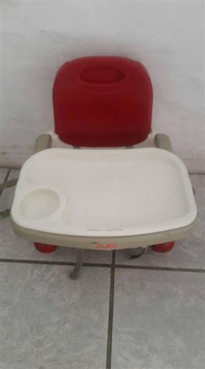 Red and white feeding chair