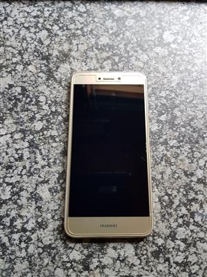 Golden colour Huawei P8 Lite 2017 smart phone  with charger , earphones , glass screen protector and rubber holder in new condition for sale R2000 cash.  Whatsapp sms or call Pierre on 0825784861.