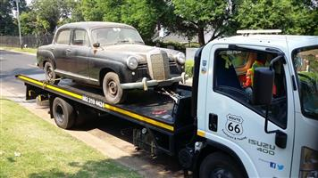 Classic Car Transport with rollback truck.