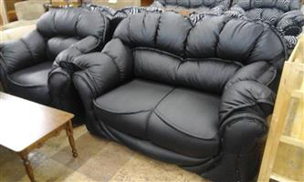 Black leather 1 and 2 seater couches