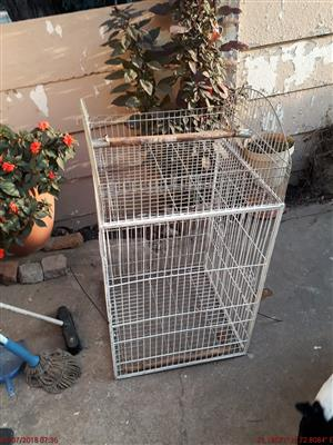 Two parrot cages one with catch tray
