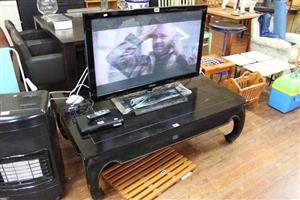 Flatscreen tv and dark wooden coffee table