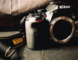 Nikon Camera with 3 lenses, battery, charger, speedlight & bag