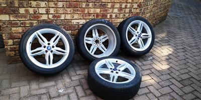 PRICE NEGOTIABLE - set of 4 almost brand new tires with rims - used to be on a KUGA Titanium 2.0TDCI