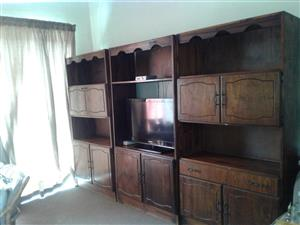 3piece wall unit, 5 cupboards, 1 drawer. Space for tv in middle cabinet. Needs tiny bit of TLC. Real wood (not chipboard).