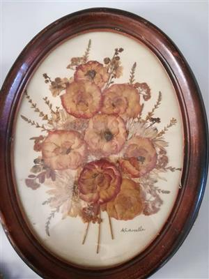 Oval wooden framed flower decor