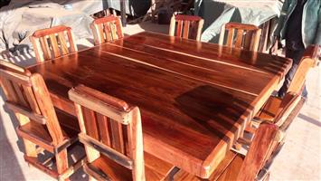8 Seater  sleeper wood dining room suite