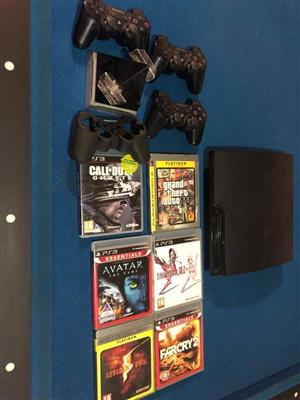 Playstation 3 with games, charging station and 3 remotes.
