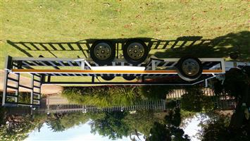 bobcat/car trailer.Double axle with brakes
