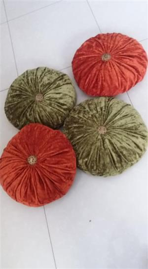Red and green pumpkin cushions