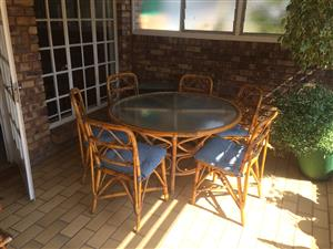 Seven piece cane glass top  round table and six chairs
