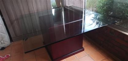 8 SEATER GLASS DINING TABLE FOR SALE.
