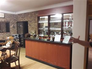 Wooden Bar with Granite Counter and seperate luminated glas shelves with lights as new.