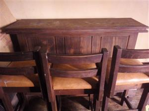 Solid wooden bar with chairs for sale