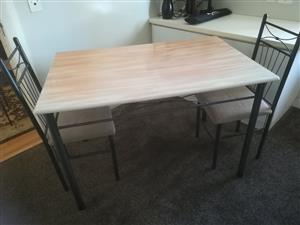 Dinette table and two matching chairs for sale.