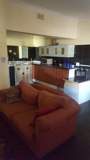 FULLY FURNISHED two bedroom flat with safe undercover parking - FULLY SERVICED DAILY, to let monthly/weekly/daily
