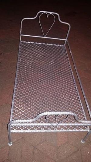 Wrought iron bed can also be use as n bench for dolls .