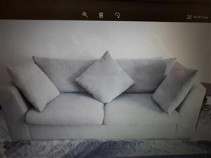 Rietvlei Heights. 3 seater Grey couch for the living room with three pillows
